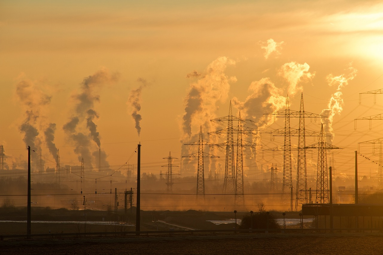 Industrial air pollution billowing from smokestacks